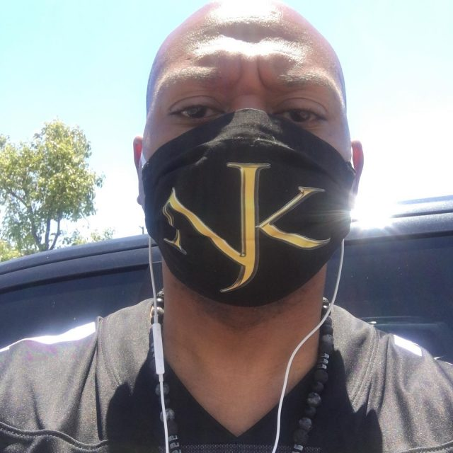 """I wanna send a quick shout to @insertverbhere for making these custom masks for me.  I wanna thank @mike_jp_ for coming through with the fabric and logo application.  It looks like we're gonna have to wear them for a while.  So, you know I had to find someone to slap the logo on a few!  These are washable and filter ready!  Hit her up if you need some!  Sorry for the """"mean mug"""" eyes...the sun was beaming🤦🏽♂️ Thanks again for hooking me up, Dr!😆 #supportblackbusiness #PROfessional #CERTIFIEDPROfessional"""